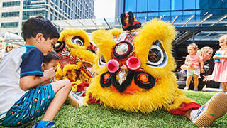 Children playing with a Lunar New Year dragon