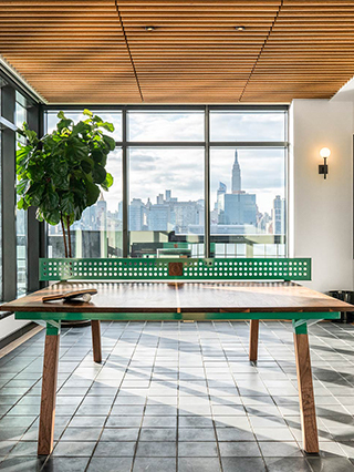 Ping pong table in a recreation room with big windows