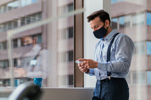 Man in office with mask on